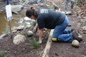 Lori burying a rock
